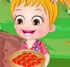 Bebê Hazel plantar tomates